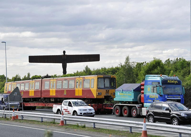 Metrocar No. 4041 passes the Angel of North on its way to refurbishment in Doncaster