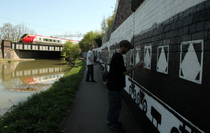 virgin train goes over wolverton canal mural Phil Marsh