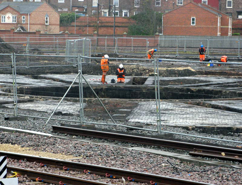 Workers inspect the two roundhouse remains. Paul Bickerdyke.