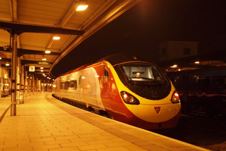Virgin Trains' Pendolino 390055 pauses at York while working 5Z10 Edinburgh – London Kings Cross, on trial for East Coast. Photo by Eliot Andersen.