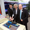 David Burbage, Theresa May, Mark Hopwood HST cake Pic by FGW