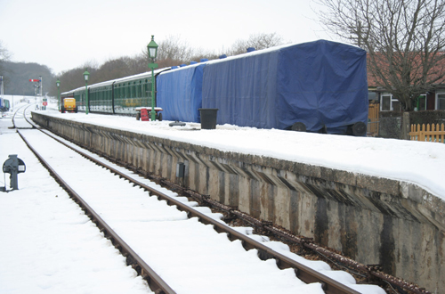 Vintage carriages stored outside in the snow by Phil Marsh
