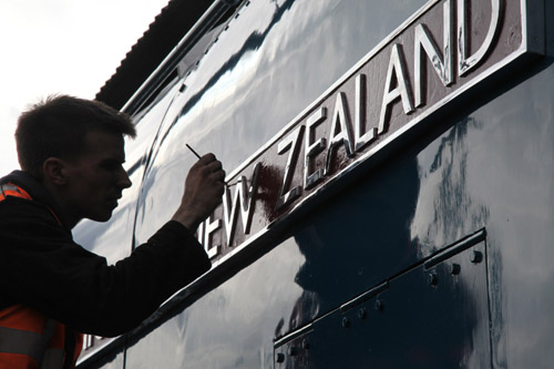 Painting the nameplate of 60019. By Phil Marsh