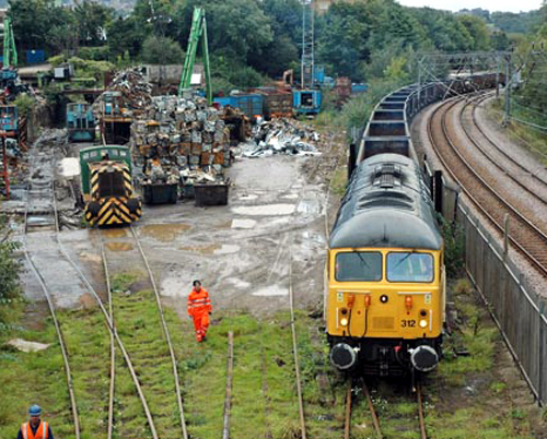 DCR No. 56312 arrives at the Crossley & Evans scrapyard in Shipley. By Paul Bickerdyke