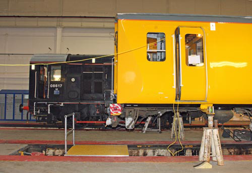 Yellow Class 313 next to diesel shunter No. 08617 courtesy of Phil Marsh