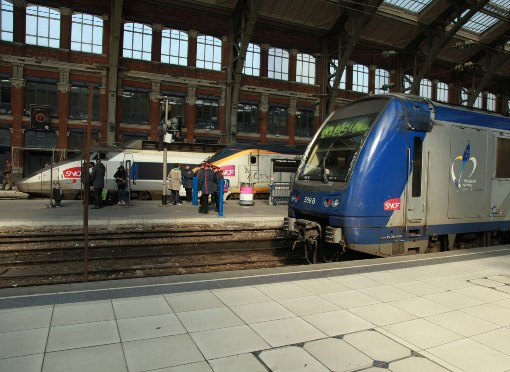 Lille where a Eurostar and a TGV mix with commuter traffic by Phil Marsh