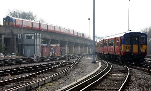 Trains at Wimbledon by Phil Marsh