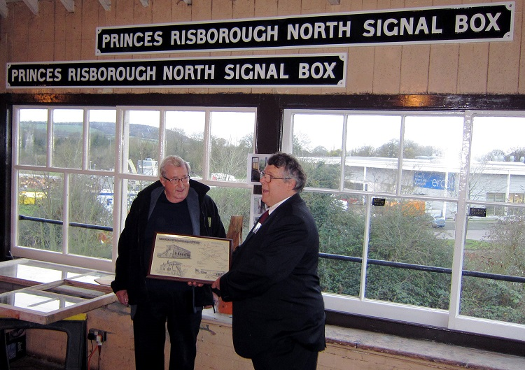 Bill McAlpine is presented with a picture of  the signalbox by Chinnor chairman Danny Woodward  Phil Marsh