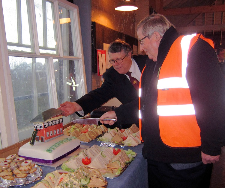 5  Bill McAlpine cuts the ceremonial cake with Chinnor chairman Danny Woodward Princes Risborough North Box Phil Marsh